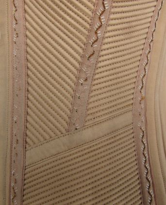 Corset (1) loss of decorative feather stitch, wear around busk posts