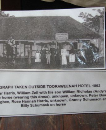 photo of the William Nicholas Zell  (in outfit) with his father in front of the Tooraweenah Pub