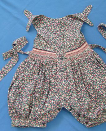 """Old Friends"" romper suit. Front view"