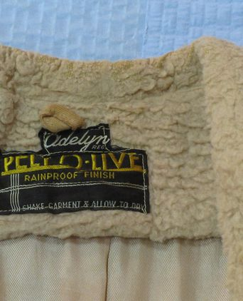 label sewn inside coat at nape of neck.