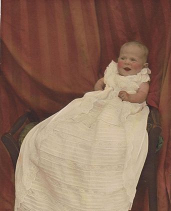 Dorothy Kalthenbach wearing the christening gown, 1938