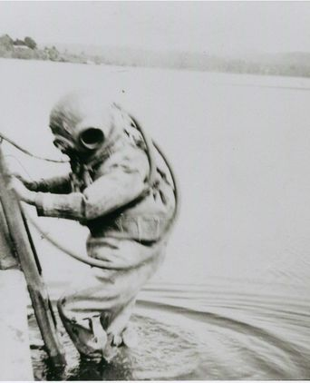 Bill Wray in full diving gear entering the Clyde River, Batemans Bay, 1938