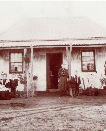 Charles and Ellen Sharam's family pictured in front of their farmhouse at Kunat, Victoria, ca. 1906