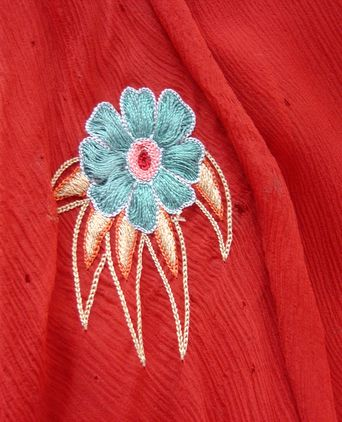 close up of embroidered flower and insect damage