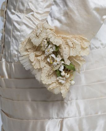 Left hand sleeve detail with lace and orange blossom spray