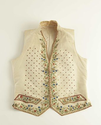 Waistcoat featuring embroidered floral emblems.