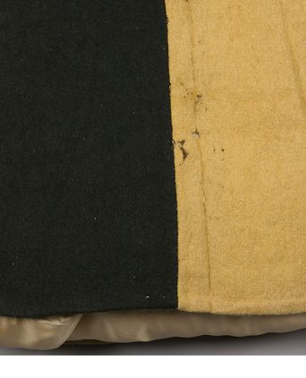 Back view of bottom of convict jacket, made in Great Britain, 1855-1880