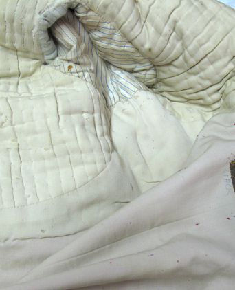 Inside tunic showing detailed tailoring and padding
