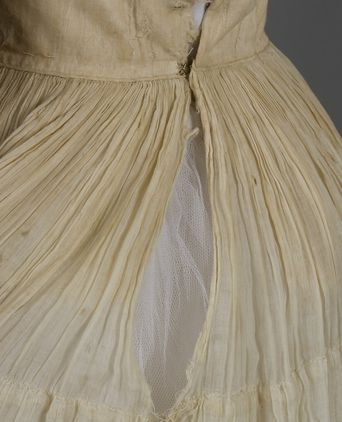 The material along the dress opening is very delicate and somewhat damaged