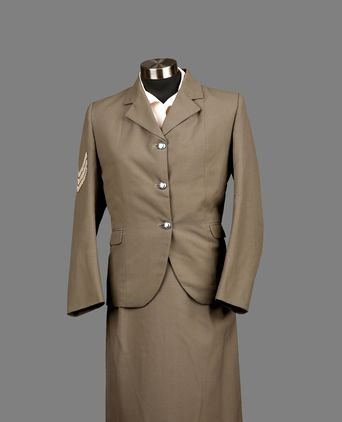 Front of policewoman's drab olive winter uniform.