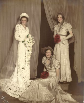 Wedding photo of bride, bridesmaid and matron of honour. Photographed at the studios of Howard Farris.