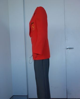 Flight Service Director uniform designed by Stewart Baker. Side view.