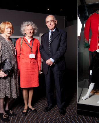 Leo Pastega with his wife Jill and Heather Waide, pictured with his childhood velveteen suit at History Week 2012