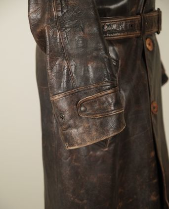 Leather coat cuff detail