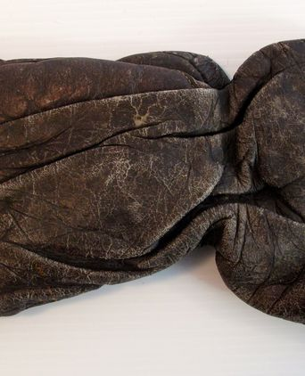 Well-worn leather glove used by Jimmy Sharman during his fights