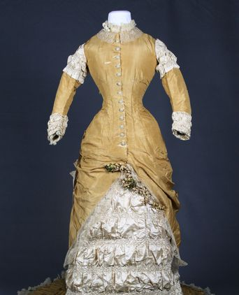 Front view of dress, highlighting details in the bodice and skirt. Note damage and splits in the silk taffeta.