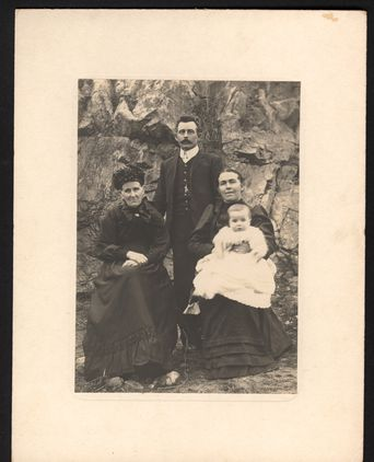 Family portrait of Thomas Hackney Wong and Amelia Eliabeth Wong nee Hackney (left) with a young woman holding an infant.