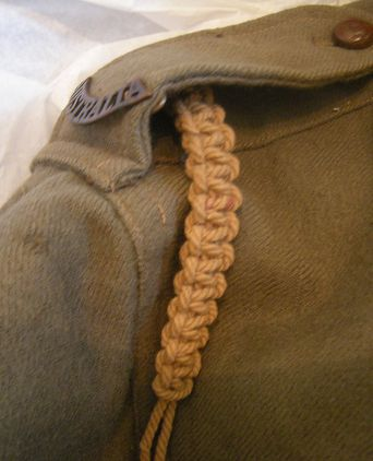 Jacket braiding on right shoulder.