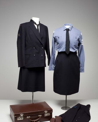 Winter dress and working uniform, and suitcase