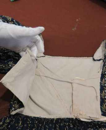 Showing front construction and hand stitching