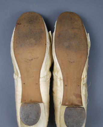 Sole of cream satin shoes showing faint marks of a Mayers Paris Stamp and medallions. Clear branding was seen under a magnifying glass