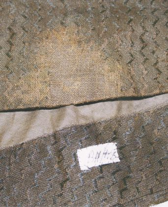 Repaired hem - lining visible