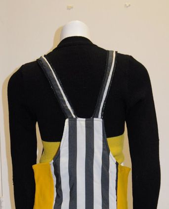 Prue Acton ski suit back view of bib & brace style pants