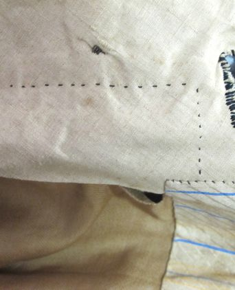 handstitched inner pants waistband showing rough buttonhole