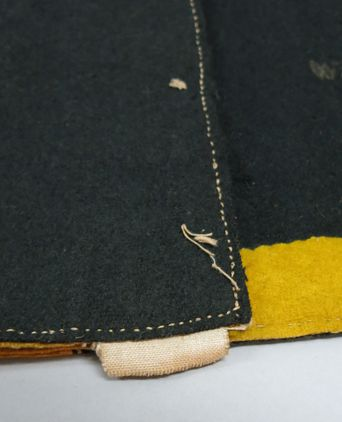 Garment bottom edge showing exposed interfacing. Photographed 24/09/2013, Deb Wise