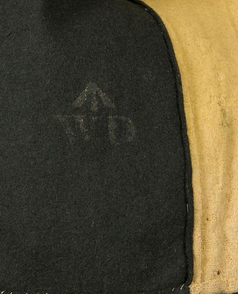 Close up of insignia on convict jacket, made in Great Britain, 1855-1880