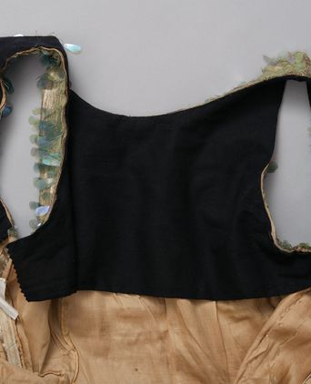 Dress, inside detail: black cotton yoke is a later addition