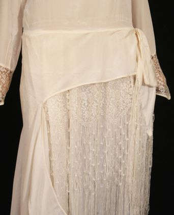 Front skirt showing lace, fringing and floating panel
