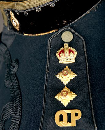 Commissioner of Police Rank Insignia attached to shoulder strap.